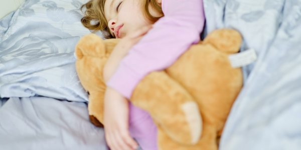 dreams of the toddler sweet girl with her bear